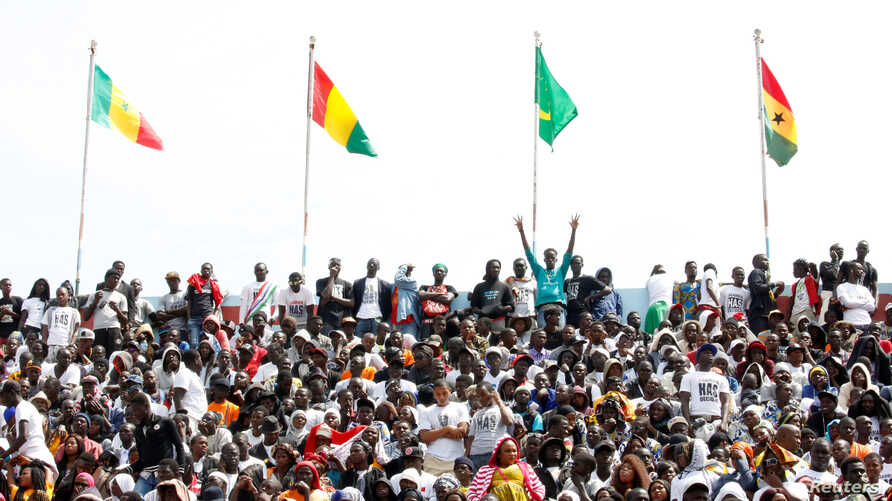 Supporters of Gambia President Adama Barrow are seen attending his swearing-in ceremony and the Gambia's Independence day at Independence Stadium, in Bakau, Gambia, Feb. 18, 2017.