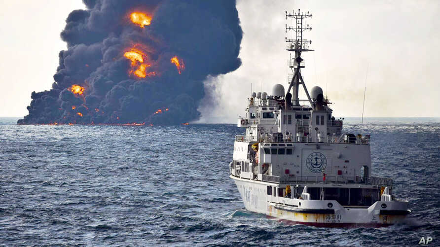 In this photo provided by China's Ministry of Transport, a rescue ship sails near the burning Iranian oil tanker Sanchi in the East China Sea off the eastern coast of China, Jan. 14, 2018.