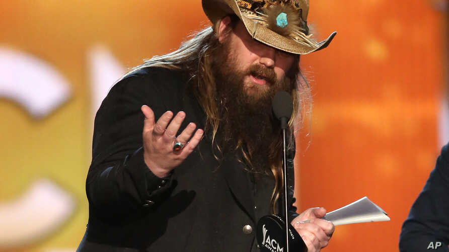 "Chris Stapleton accepts the award for album of the year for ""Traveller"" at the 51st annual Academy of Country Music Awards at the MGM Grand Garden Arena, April 3, 2016, in Las Vegas."