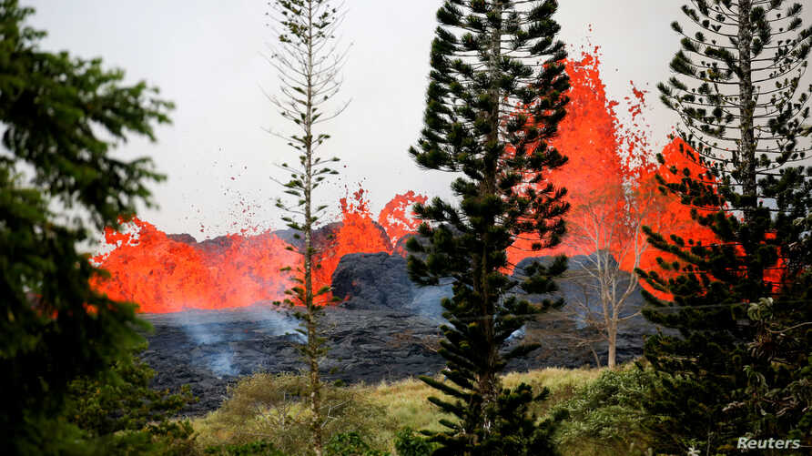 Lava erupts on the outskirts of Pahoa during eruptions of the Kilauea volcano in Hawaii,  May 19, 2018.