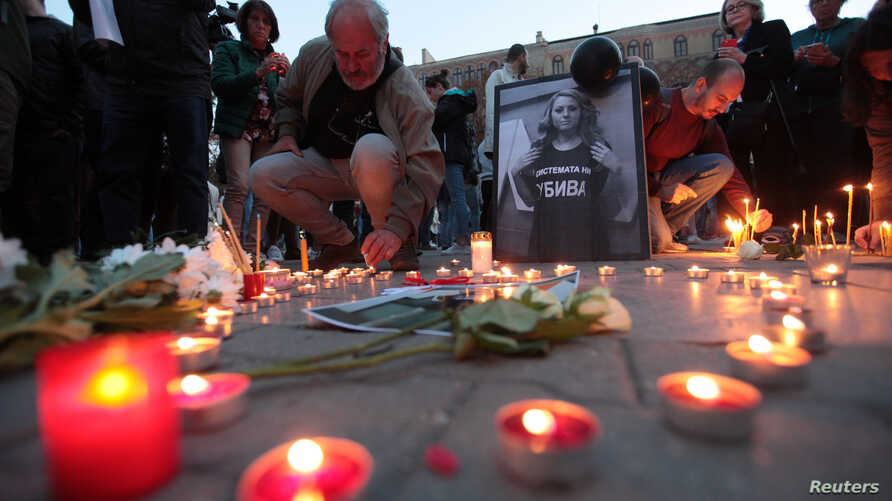 People take part in a candle-light vigil in memory of Bulgarian TV journalist Viktoria Marinova in Sofia, Bulgaria, Oct. 8, 2018.