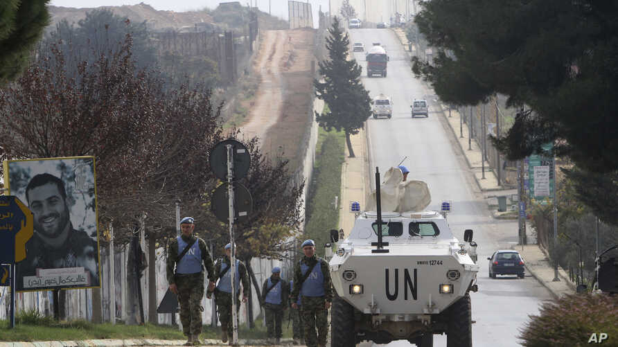 """Serbian U.N peacekeepers patrol the Lebanese side of the Lebanese-Israeli border in the southern village of Kfar Kila, Lebanon, Tuesday, Dec. 4, 2018. The Israeli military launched an operation on Tuesday to """"expose and thwart"""" tunnels it says were b"""