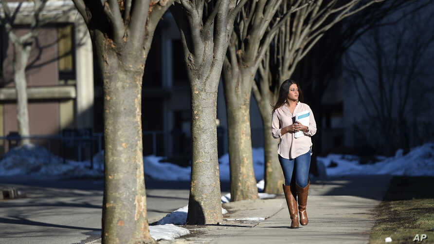 Naila Amin, 26, walks through the campus of Nassau Community College where she is a student in Garden City, New York, Feb. 2, 2016. Amin, who was forced into marriage at the age of 15 to a 28-year-old cousin in Pakistan who beat and mistreated her, a