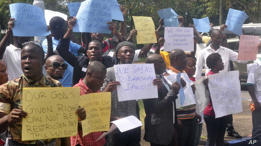 FILE - Liberians stage a protest outside the National Assembly against the government not doing enough to fight Ebola virus in Monrovia, Liberia, Oct. 9, 2014.