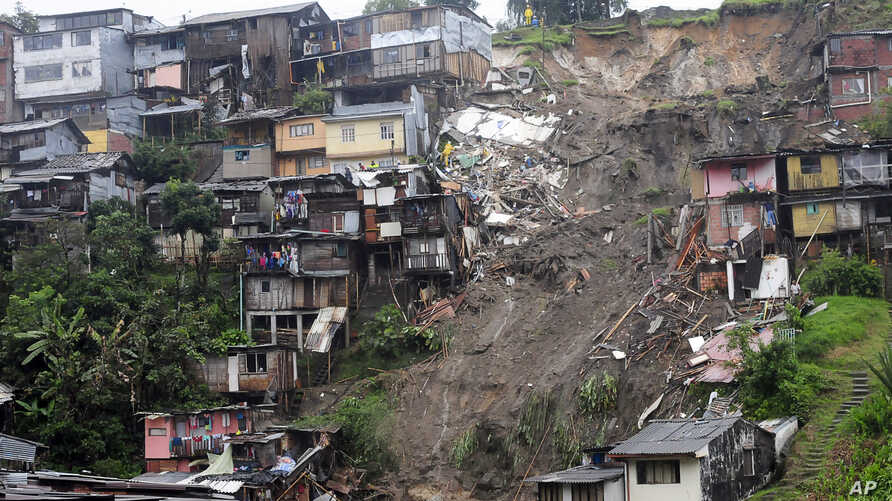 View of a landslide that destroyed several houses in Manizales, Colombia, April 19, 2017. At least seven people are dead after intense rains provoked several landslides in a mountainous, coffee-growing part of Colombia.