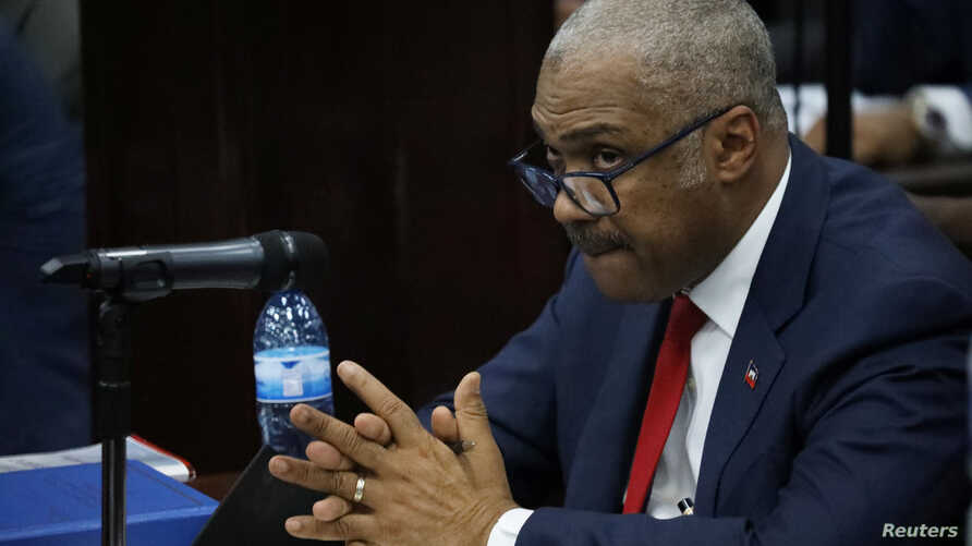 Haiti's Jack Guy Lafontant gestures during a meeting with members of the Parliament in Port-au-Prince, July 14, 2018. He resigned after days of protest over planned fuel price hikes.
