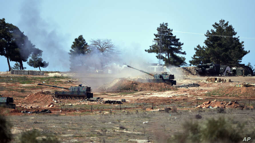 Turkish artillery fire from the border near Kilis town toward northern Syria, in Kilis, Turkey, Feb. 16, 2016.
