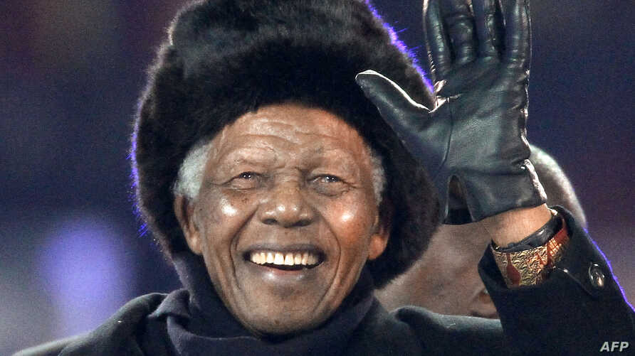 South Africa's former President Nelson Mandela waves as he arrives to attend the 2010 World Cup football final Netherlands vs. Spain on July 11, 2010 at Soccer City stadium in Soweto, suburban Johannesburg.