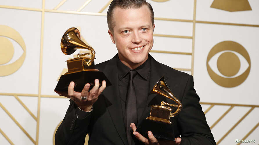 Jason Isbell holds the awards for Best Americana Album and Best American Roots Song during the 58th Grammy Awards in Los Angeles, Feb. 15, 2016.