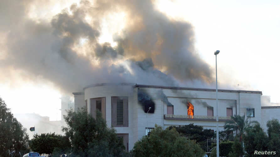 Smoke rises from the site of the headquarters of Libya's foreign ministry after suicide attackers hit in Tripoli, Libya Dec. 25, 2018.