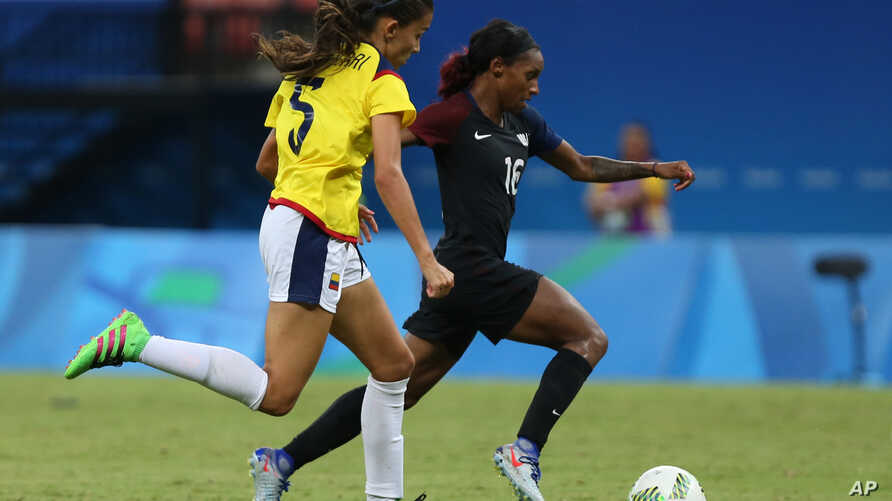 FILE - Colombia's Isabella Echeverri, left, and United States' Crystal Dunn go for the ball during a group G match of the women's Olympic football tournament between Colombia and United States at the Arena Amazonia stadium in Manaus, Brazil, Aug. 9,