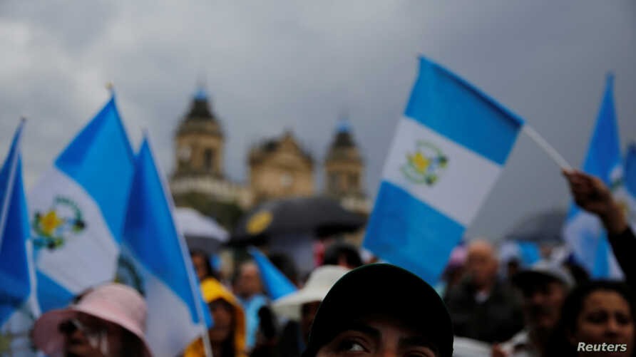 Demonstrators take part in a protest against Guatemalan President Jimmy Morales and his decision not to renew the mandate of the CICIG, in Guatemala City, Guatemala, Sept. 1, 2018.