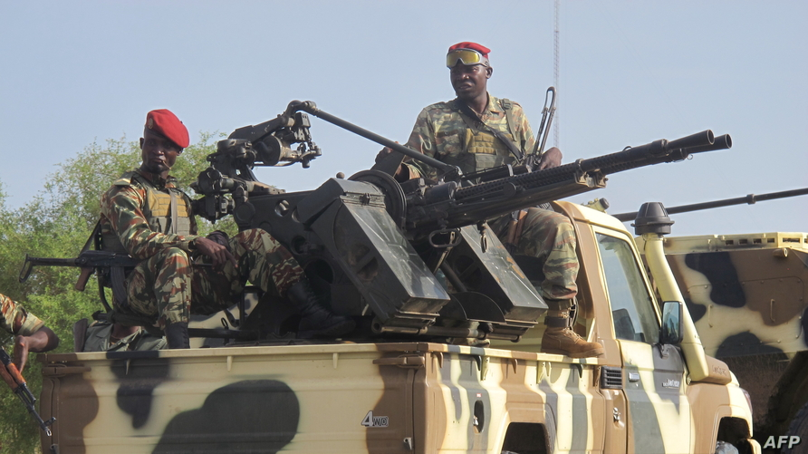 FILE - A convoy of Cameroon's army soldiers as part of a reinforcement of its military forces against Nigerian Islamist group Boko Haram.