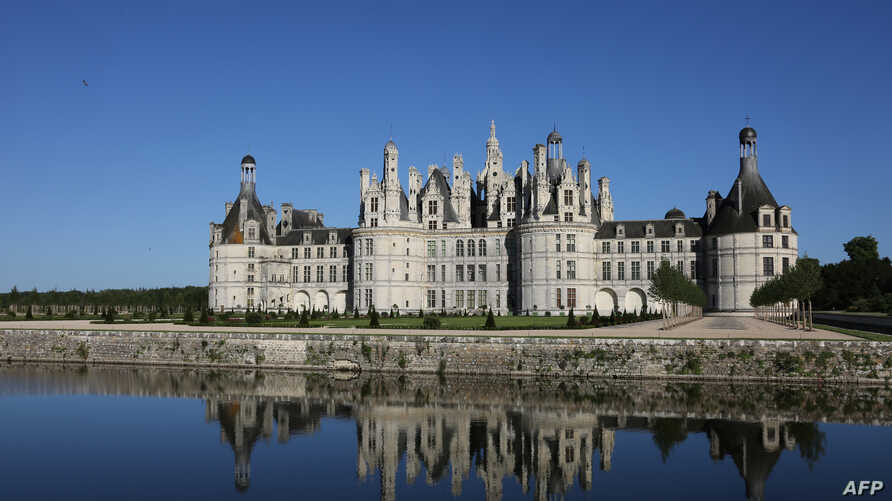 A picture taken June 12, 2017, shows the Chateau de Chambord (The Castle of Chambord) in Chambord, France. French President Emmanuel Macron will celebrate his 40th birthday on the grounds of the former royal palace.