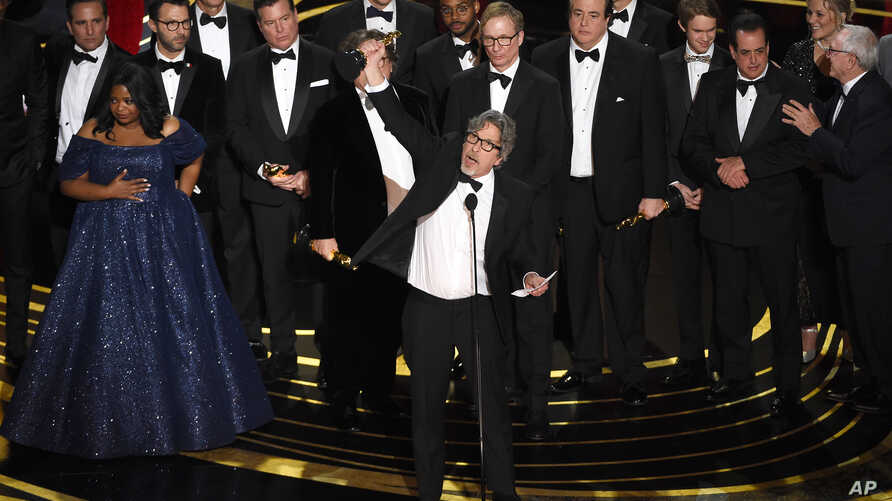 "Peter Farrelly, center, and the cast and crew of ""Green Book"" accept the award for best picture at the Oscars on Sunday, Feb. 24, 2019, at the Dolby Theatre in Los Angeles."