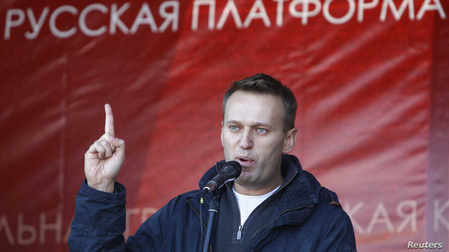 Russian lawyer and blogger Alexei Navalny attends a rally in Moscow, October 22, 2011.
