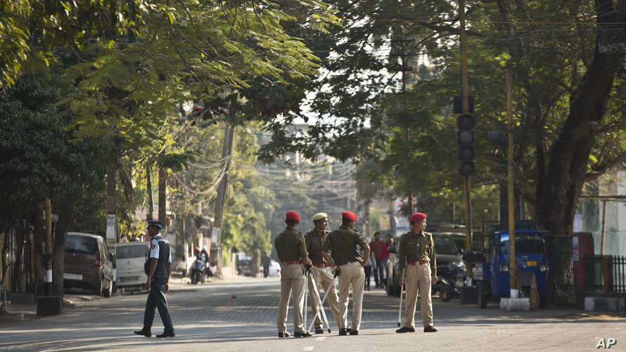 Indian police officers stand on a deserted street during an eleven hour general strike called by All Assam Students' Union (AASU) and North East Students' Organization (NESO) in Gauhati, India, Jan. 8, 2019, protesting a new citizenship bill.