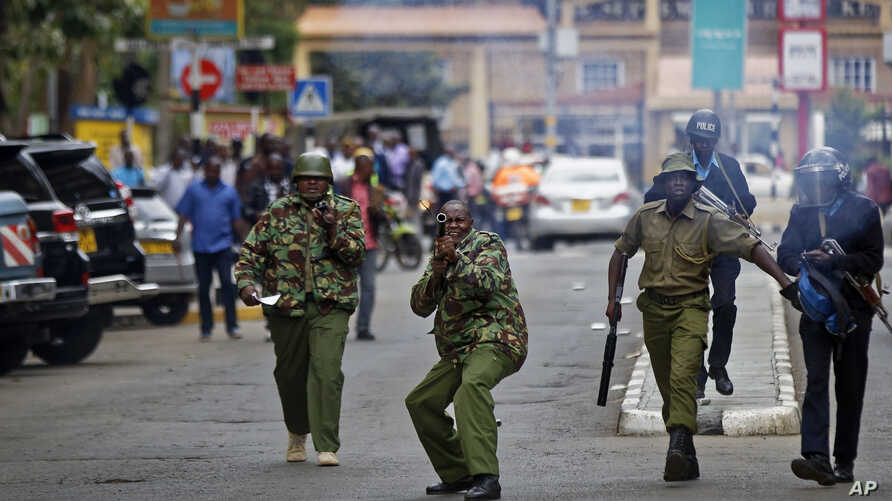 Kenyan police fire tear gas grenades at supporters of opposition leader Raila Odinga as they attempt to demonstrate in downtown Nairobi, Kenya, Oct. 24, 2017.