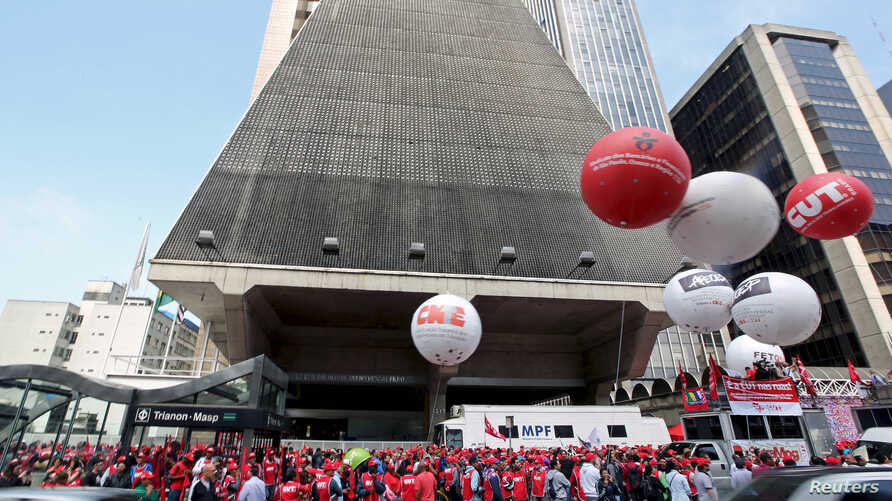 People from various social movements and union workers attend a demonstration in support of human rights and democracy at Paulista avenue in Sao Paulo financial center, Brazil, September 15, 2015.