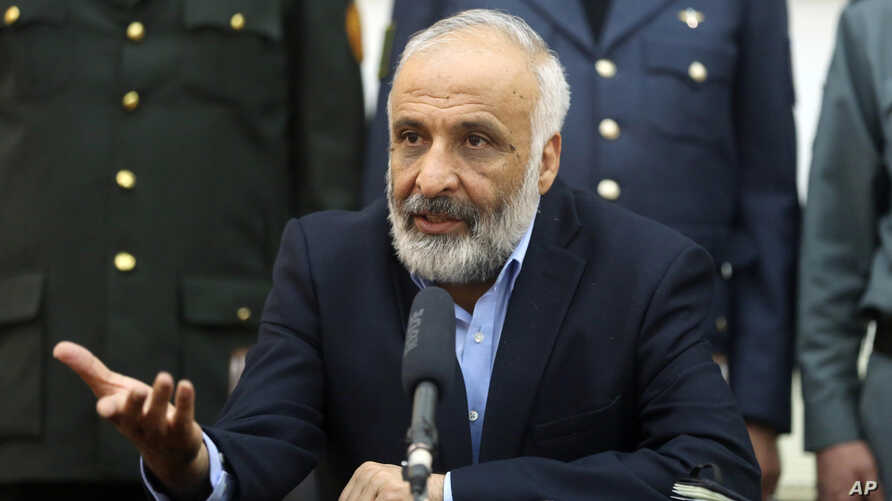 FILE - Masoom Stanikzai talks during a press conference at presidential palace in Kabul, Afghanistan.