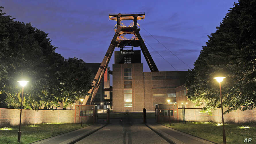 FILE - The winding tower is illuminated as a part of the European Cultural Capital Ruhr 2010 project at the former coal mine Zeche Zollverein in Essen, western Germany, June 13, 2010.