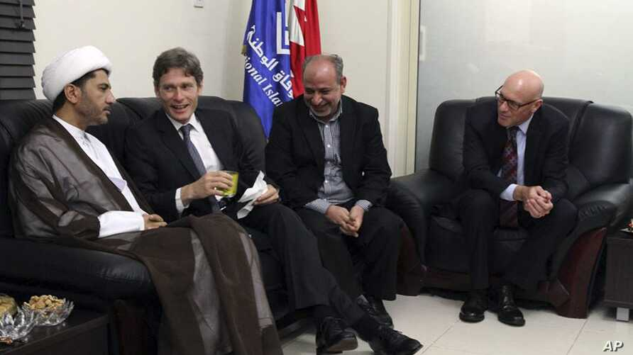 In a photo released by Bahraini opposition group, Al Wifaq, U.S. Assistant Secretary of State for Democracy, Human Rights and Labor Tom Malinowski, second left, visits with Sheikh Ali Salman, head of Wifaq National Islamic Society, left, former membe
