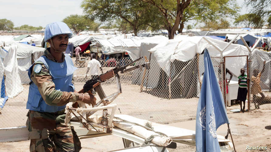 A U.N. peacekeeper keeps guard outside a refugee camp in Bor, South Sudan, on April 29, 2014.