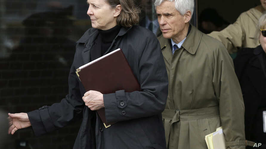 Defense attorneys Judy Clarke, left, and David Bruck leave federal court in Boston where their client Dzhokhar Tsarnaev was convicted on multiple charges in the 2013 Boston Marathon bombing, April 8, 2015.