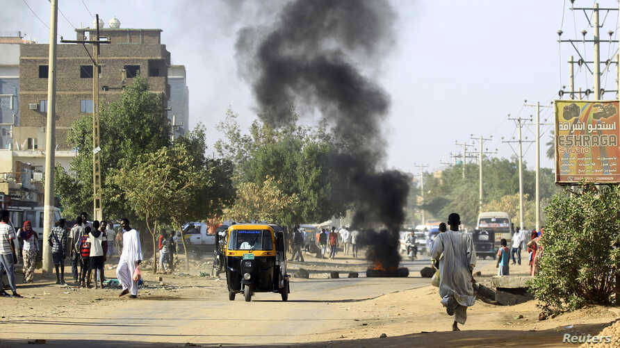 A tire is seen burning during anti-government protests in Khartoum, Sudan, Jan. 24, 2019.