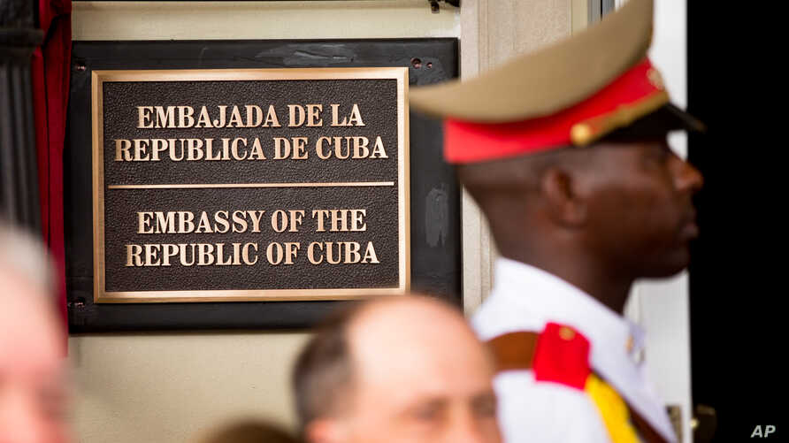A member of the Cuban honor guard stands next to a new plaque at the front door of the newly reopened Cuban embassy in Washington, July 20, 2015.