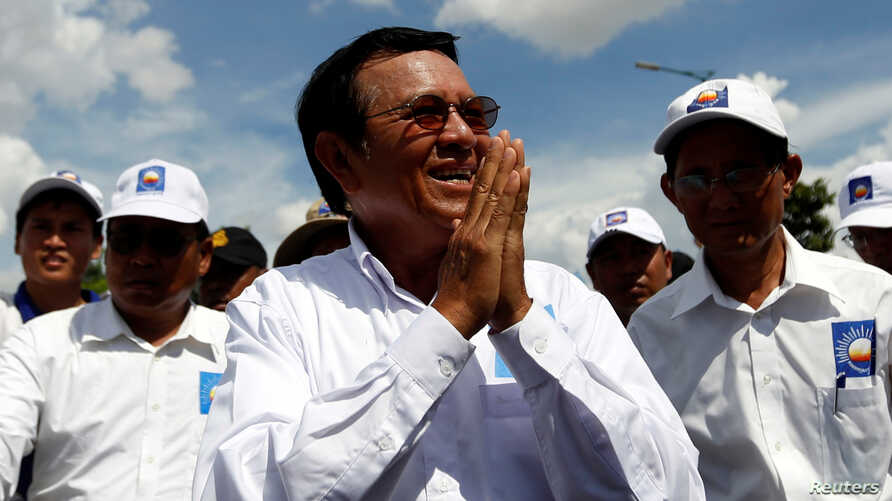 The president of the opposition Cambodia National Rescue Party, Kem Sokha, arrives at a campaign rally in Phnom Penh, June 2, 2017.