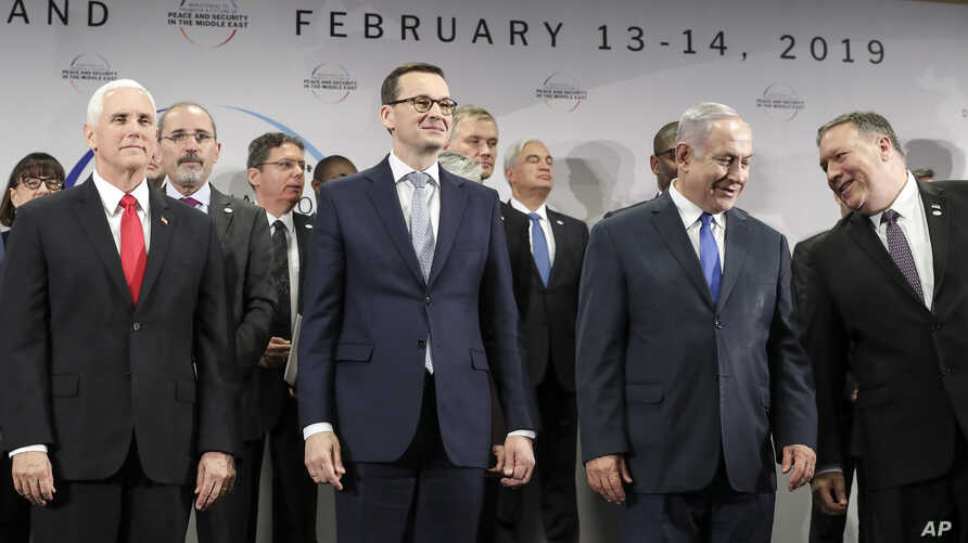U.S. Vice President Mike Pence, PM of Poland Mateusz Morawiecki, Israeli PM Benjamin Netanyahu and U.S. Secretary of State Mike Pompeo, from left, stand on a podium at a conference on Peace and Security in the Middle East in Warsaw, Poland.