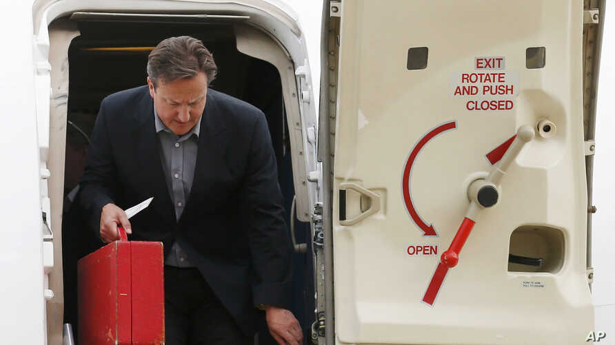 FILE - Britain's Prime Minister David Cameron is seen stepping off a plane in a June 16, 2013, photo.