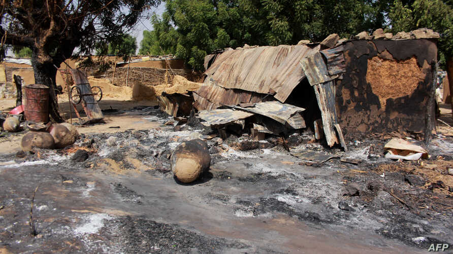 FILE - A picture taken Dec. 17, 2018, shows mud houses burned down by Boko Haram fighters in Maiborti village, on the outskirts of Maiduguri, Nigeria. Fighters from the Islamic State West Africa Province overran military posts inBornostate on Jan.