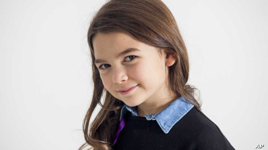 """Actress Brooklynn Prince poses for a portrait in New York to promote her film, """"The Florida Project,"""" Nov. 28, 2017."""