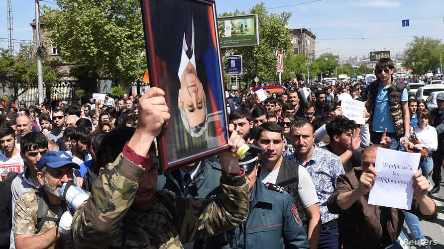 Demonstrators attend a protest after parliament voted to allow former president Serzh Sarksyan to become prime minister, in Yerevan, Armenia, April 19, 2018.