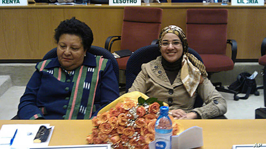 Prof. Dosso Mireille Carmen of Ivory Coast and Prof. Dr. Ebtehal El Demerdash of Egypt at AU headquarters to receive the Kwame Nkrumah Science Prize, December 14, 2011.