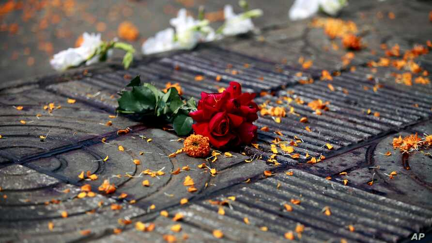 Flowers lie at the site where Avijit Roy was attacked and killed, in Dhaka, Bangladesh on Feb. 27, 2015. Roy, a prominent Bangladeshi-American blogger, known for speaking out against religious fundamentalism was hacked to death in the streets of Bang