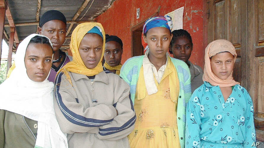 FILE - Teenage girls who have all been victims of abduction for marriage are seen Wednesday, Sept. 8, 2004, in Arsi, eastern Ethiopia.