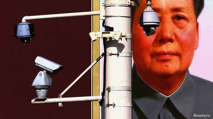 Security cameras in front of the giant portrait of former Chinese Chairman Mao Zedong on Beijing's Tiananmen Square, Nov. 11, 2012.