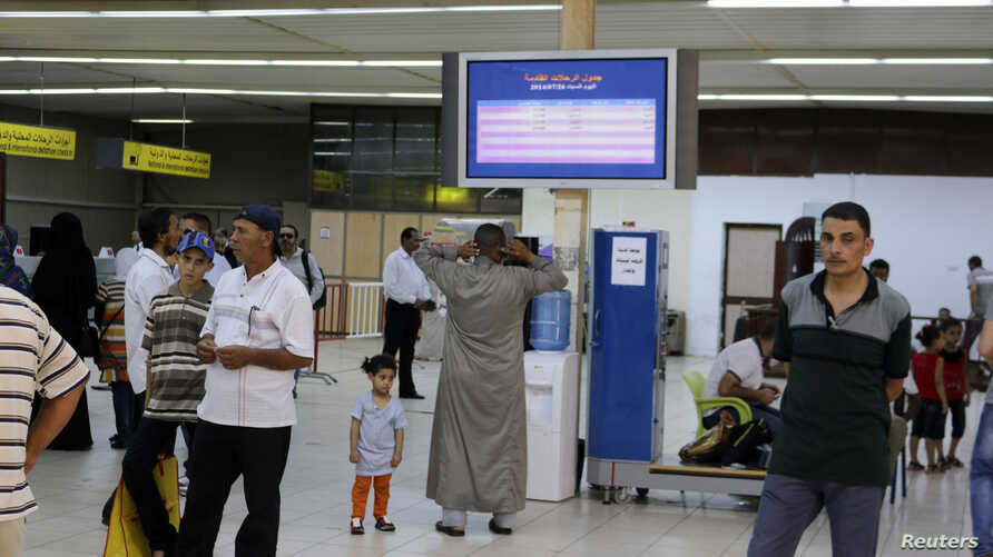 Passengers are seen in a hall at Tripoli's Mitiga airport, after clashes between rival militias closed down Tripoli International Airport, July 27, 2014.