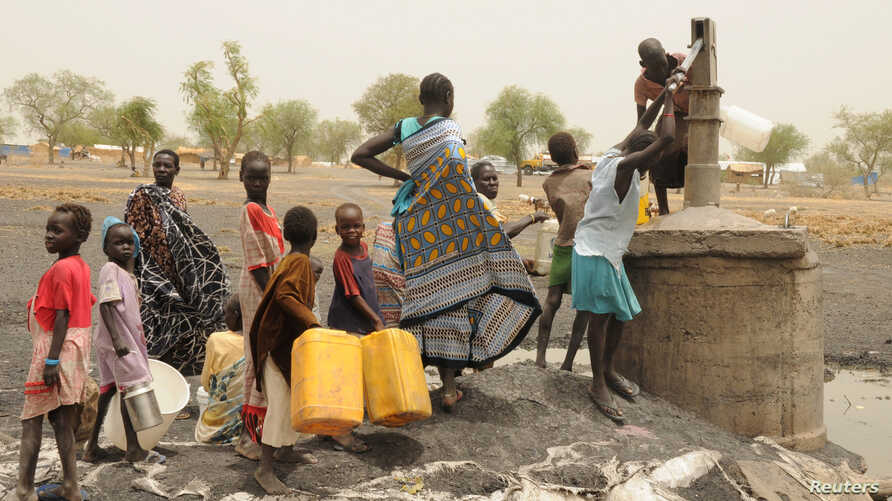 FILE - Internally displaced people collect water from a borehole at a camp near Kodok in the north-eastern South Sudanese state of Western Nile, April 17, 2017.