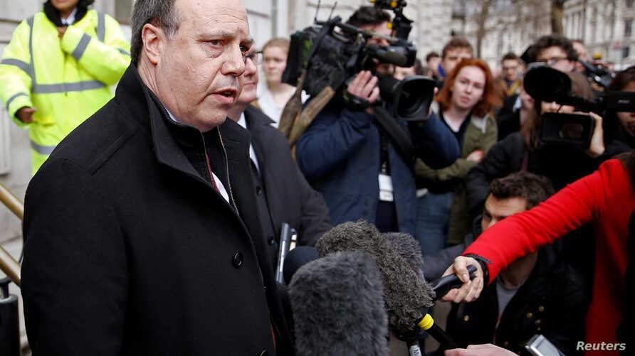 FILE - Democratic Unionist Party deputy leader Nigel Dodds speaks to reporters outside the Cabinet Office, in London, March 15, 2019.