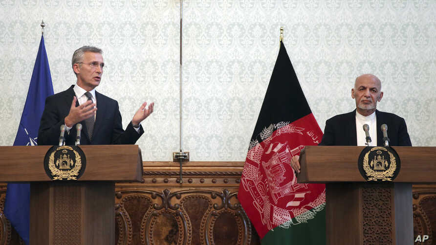 Afghan President Ashraf Ghani, right, listens as NATO Secretary General Jens Stoltenberg speaks during a press conference at the presidential palace, in Kabul, Afghanistan, Nov. 6, 2018.
