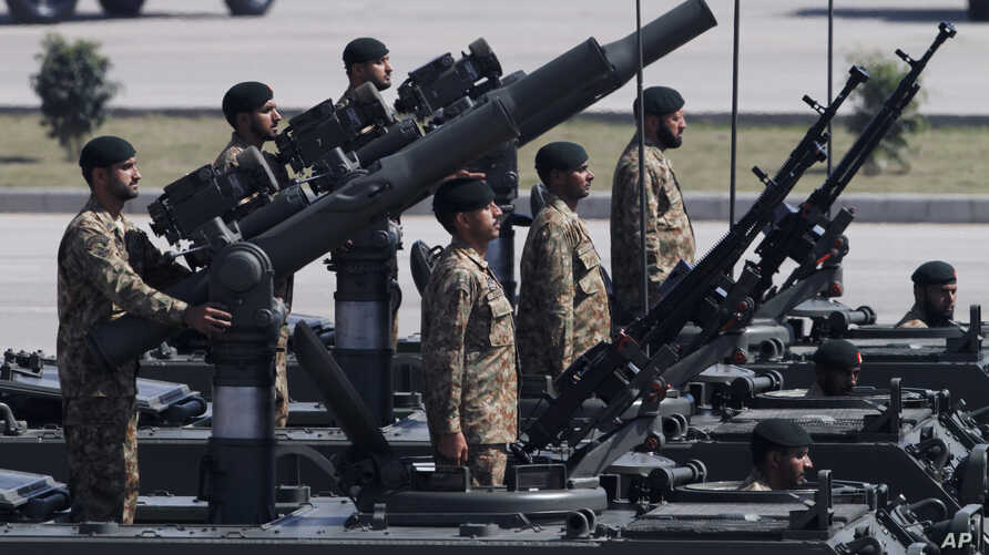 FILE - Army troops take part in the Pakistan National Day parade in Islamabad, Pakistan.