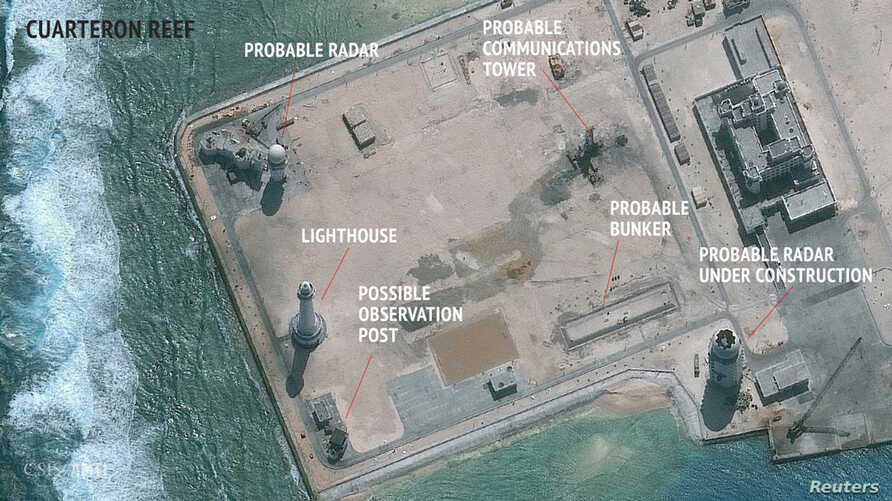 A satellite image released by the Asian Maritime Transparency Initiative at Washington's Center for Strategic and International Studies shows construction of possible radar tower facilities in the Spratly Islands in the disputed South China Sea in th...