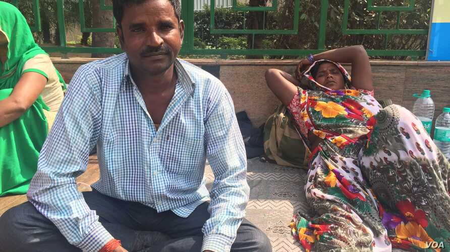 Shavan Kumar has travelled to New Delhi with his wife from his village to get her treated for a heart condition at a government hospital, where treatment is free. (A. Pasricha/VOA)