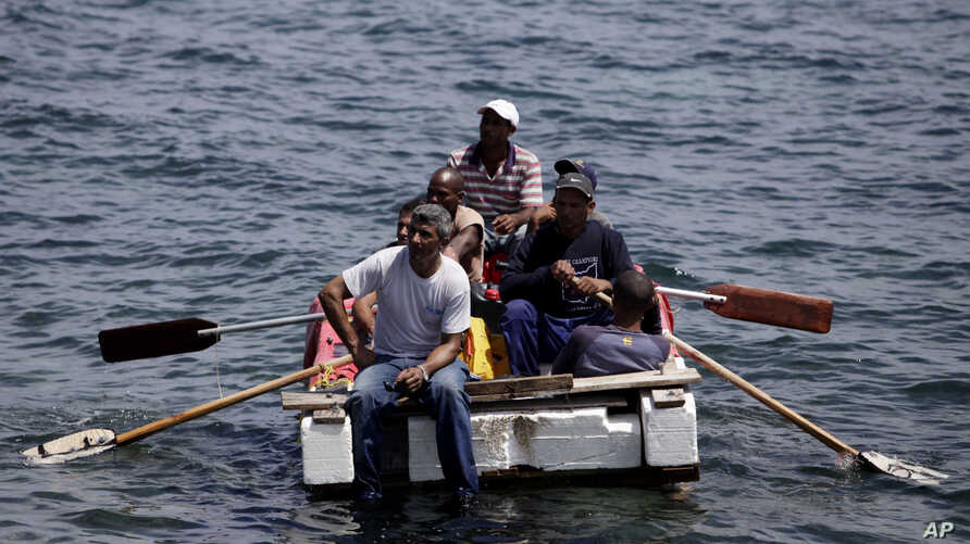 Seven men trying to migrate illegally to the United States on a raft are stopped by Cuba's Coast Guard near Havana, June 4, 2009.