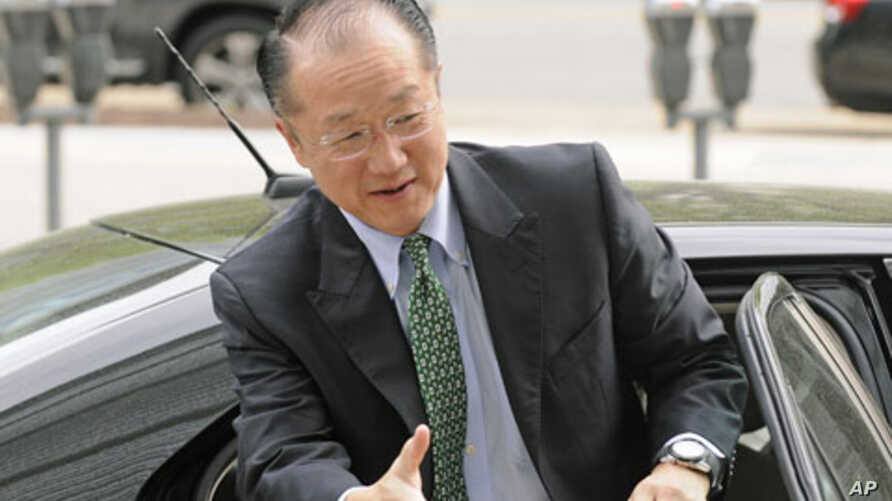New head of the World Bank and former Dartmouth College president, Jim Yong Kim, reaches out to shake hands as he arrives for meetings at the bank's headquarters in Washington, April 11, 2012.