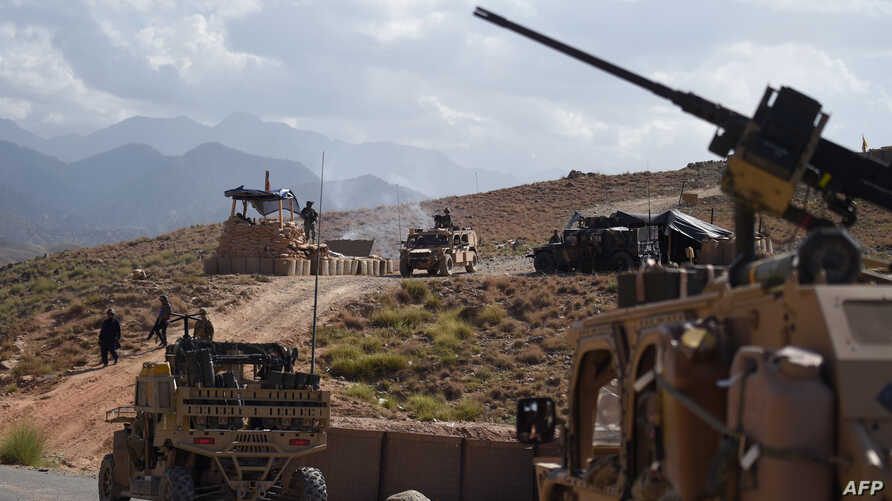 FILE - In this photo taken on July 7, 2018, US Army from NATO and Afghan commando forces are pictures in a checkpoint during a patrol against Islamic State militants at the Deh Bala district in the eastern province of Nangarhar Province.